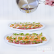 Nobu's New Style Sashimi - Thin slices of fresh fish, topped with garlic, ginger, scallions, ponzu and lightly cooked with hot sesame oil | designsofanykind.com