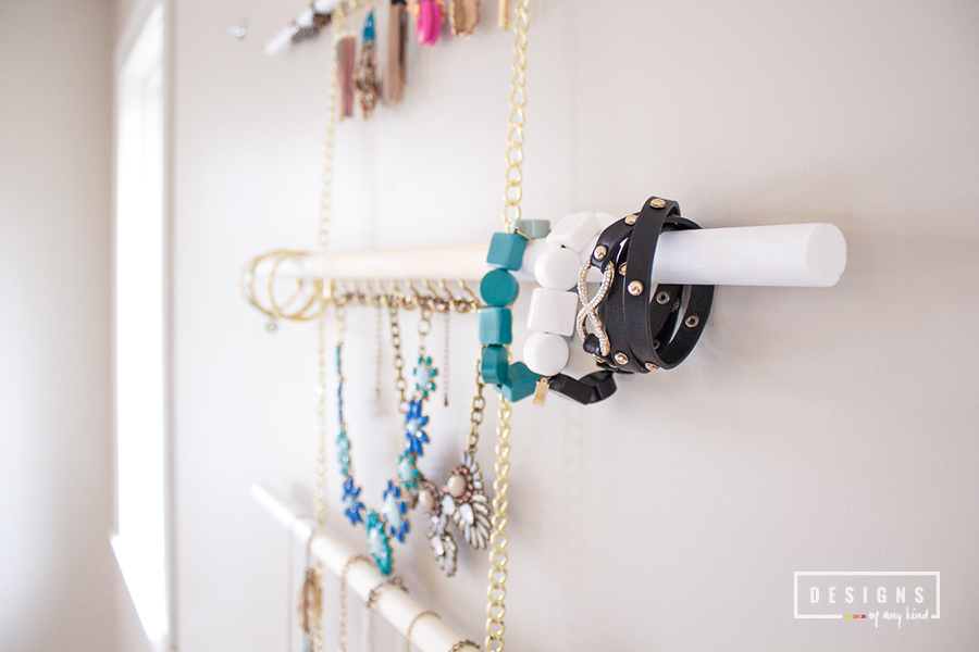 DIY // Modern Hanging Jewelry Organizer. A beautiful and modern way to organize and store that unending amount of jewelry you own. The perfect weekend DIY project! Find out more at www.designsofanykind.com