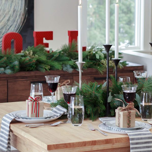 Get inspired by this simple + thrifted holiday tablescape - an easy look to create for any entertaining you may do with friends and family this Christmas. Discover more at www.designsofanykind.com