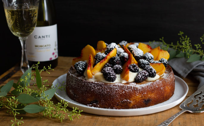 Sparkling Moscato wine meets fresh peaches and blackberries in this dense, rich Blackberry Peach Moscato Cake. A sweet, summery dream come true! Recipe at www.designsofanykind.com